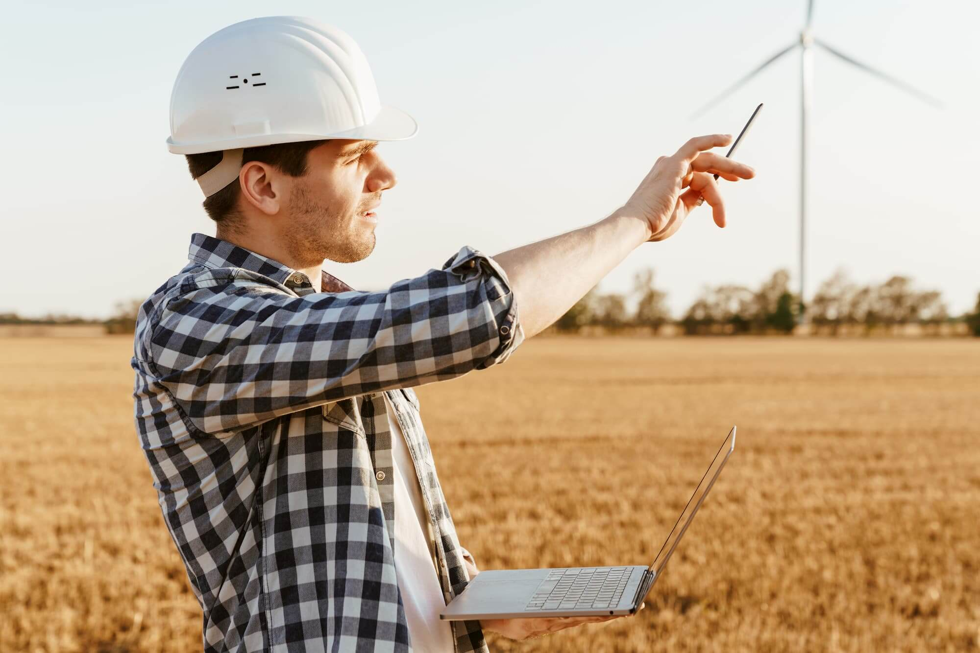 An electrical engineer standing on a field with wi fqptvat 1 : windesco : windesco